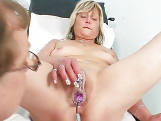 lewd blonde granny toys her pussy at gyno clinic